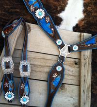 Hand tooled tack set. Turquoise acid wash hair on linlays and daisy hardware.