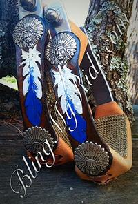 Hand tooled and painted feather stirrups with indian chief head conchos.