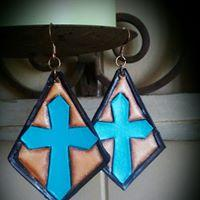 Hand tooled and painted leather dangle earrings.