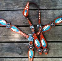 "Hand tooled and painted ""feathered"" tack set w. white buckstitch."