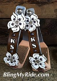 "Floral ""cut-out"" stirrups."