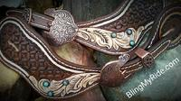 Hand tooled spur straps with turquoise cabachons.