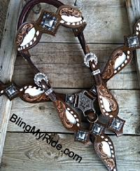 Hand tooled and buckstitched tack set with browband headstall. White buckstitch, bone or white croc.
