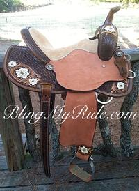 Hand tooled and painted barrel saddle with round skirt.