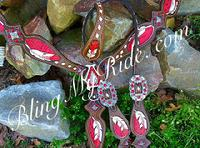 Hand tooled and painted and buckstitched feather set with red inlays and red bling.