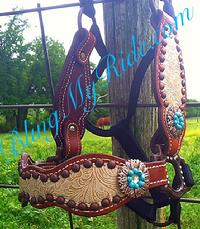 Floral embossed overlay bronc style halter.
