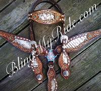 Gorgeous hand tooled tack set with bone and metallic croc. inlays and sleeping beauty turquoise accents.