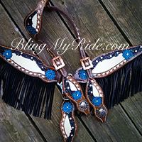Hand tooled, painted and buckstitched bling tack set with fringe. (turquoise flowers).