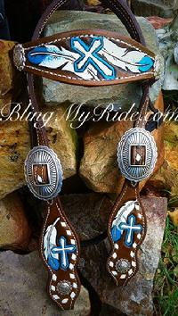 Hand tooled , painted and buckstitched browband headstall. Feather and cross.