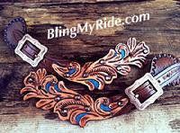 Scroll cut out hand tooled spur straps with turquoise accents.