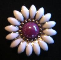 Purple and white flower concho.