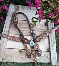 Hand tooled scroll cut-out set. Turquoise inlay paint and buckstitch.