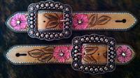 Hand tooled and pianted belt style spur straps.