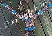 Hand tooled and painted bling tack set with turquoise flowers.
