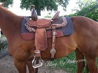 Hand tooled and buckstitched barrel saddle with Swarovskis and embossed croc. seat.